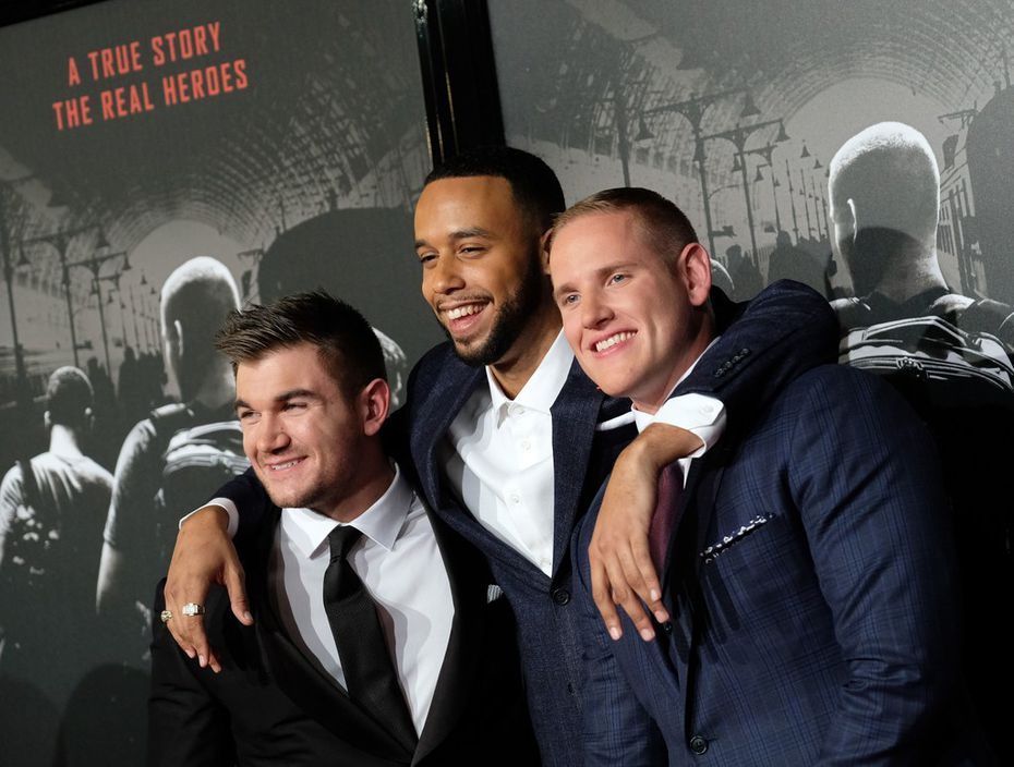 """(L-R) Former U.S. National Guardsman Alek Skarlatos, Anthony Sadler and former U.S. Air Force staff sergeant Spencer Stone arrive for the world premiere of """"The 15:17 to Paris"""" at the Warner Bros. Studios SJR theatre in Burbank, California, on February 5, 2018."""