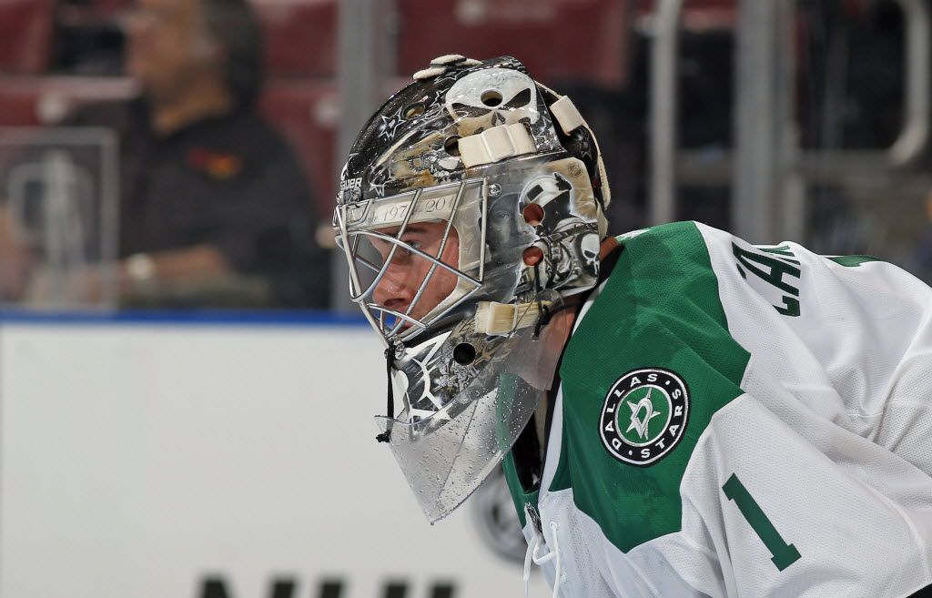 A detailed view of the mask of Dallas Stars goaltender Jack Campbell (1) during the second period of an NHL preseason hockey game against the Florida Panthers, Tuesday, Sept. 22, 2015, in Sunrise, Fla. The Panthers defeated the Stars 3-2. (AP Photo/Joel Auerbach)