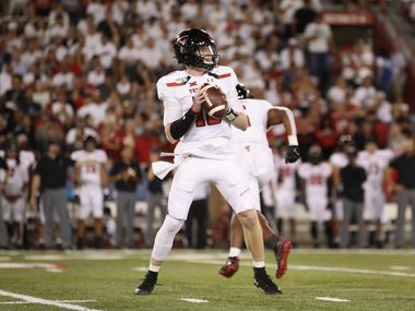 TUCSON, ARIZONA - SEPTEMBER 14:  Quarterback Alan Bowman #10 of the Texas Tech Red Raiders looks to pass during the first half of the NCAAF game against the Arizona Wildcats at Arizona Stadium on September 14, 2019 in Tucson, Arizona.