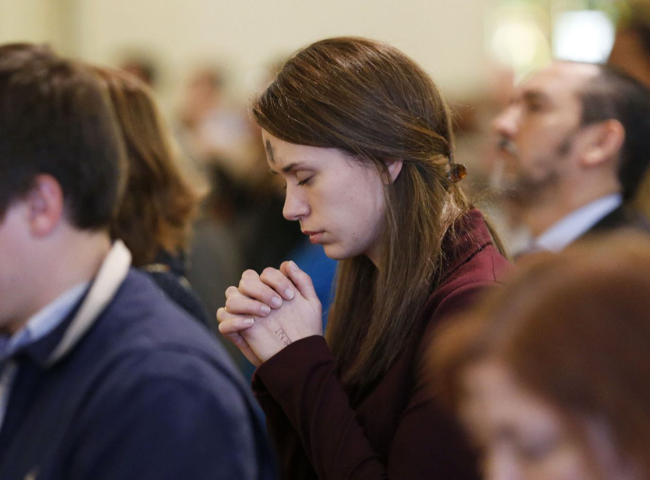Shelby Cielencki of Dallas prays during Ash Wednesday Mass at the Cathedral Shrine of the Virgin of Guadalupe in Dallas on March 1. Ash Wednesday marks the beginning of Lent.