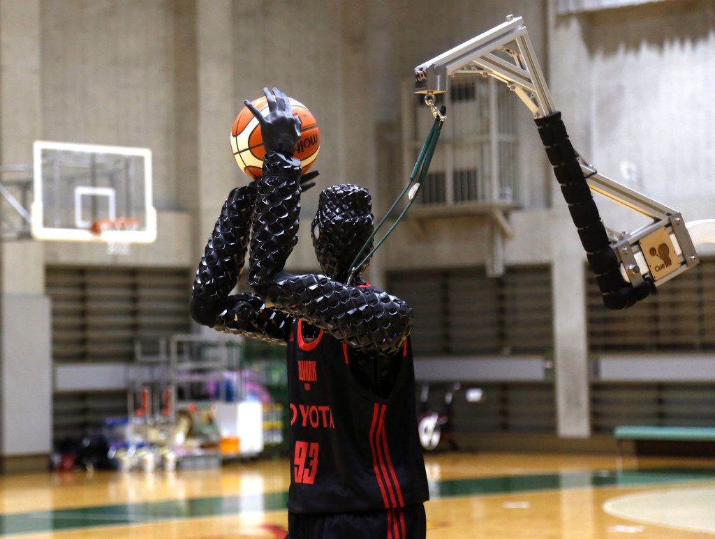 Toyota's basketball robot Cue 3 demonstrates Monday, April 1, 2019 at a gymnasium in Fuchu, Tokyo.
