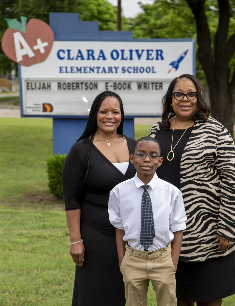 Elijah Robertson, 10, has gotten encouragement from his teacher Robin Bryan (left) and principal Cheryl Freeman at Clara Oliver Elementary School.
