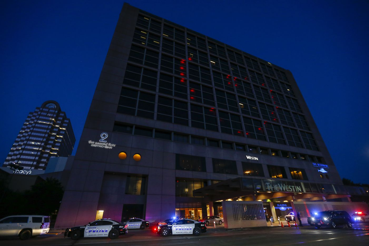 A red heart is highlighted by windows of the Westin Hotel as police work below at the Galleria Mall, where a shooting was reported Tuesday, June 16, 2020 in Dallas.