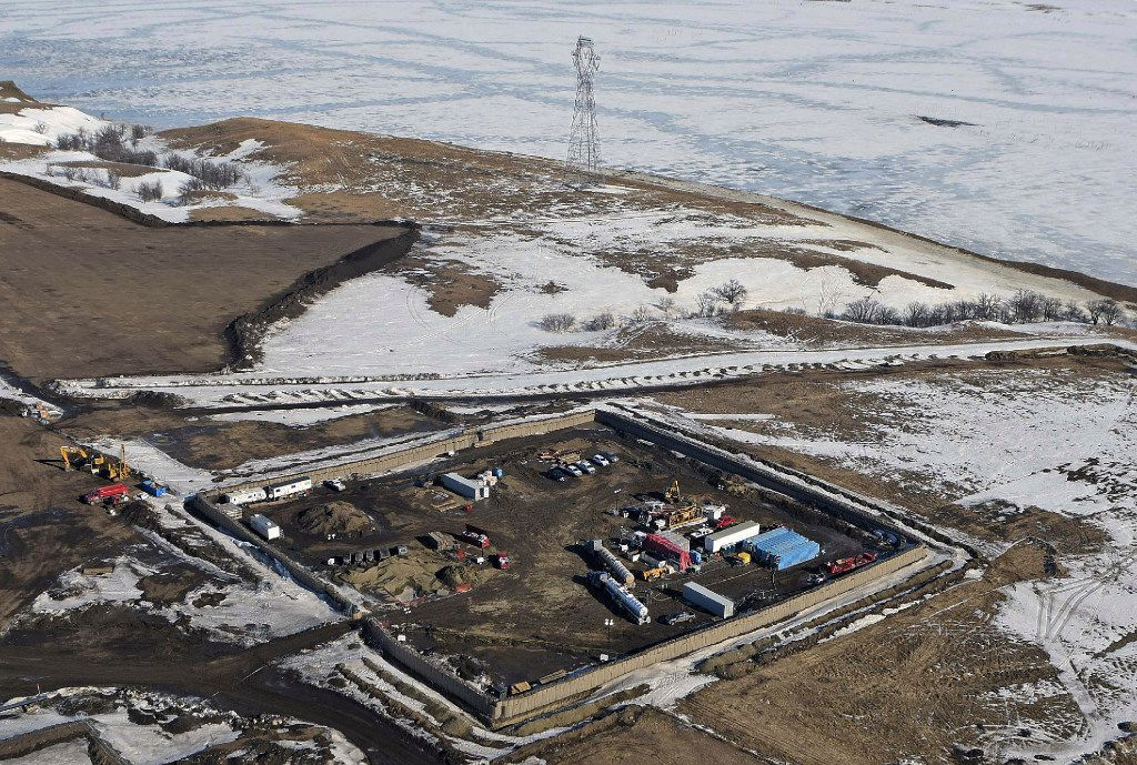 This Feb. 13, 2017, file aerial photo shows a site where the final phase of the Dakota Access Pipeline will take place with boring equipment routing the pipeline underground and across Lake Oahe to connect with the existing pipeline in Emmons County in Cannon Ball, N.D.