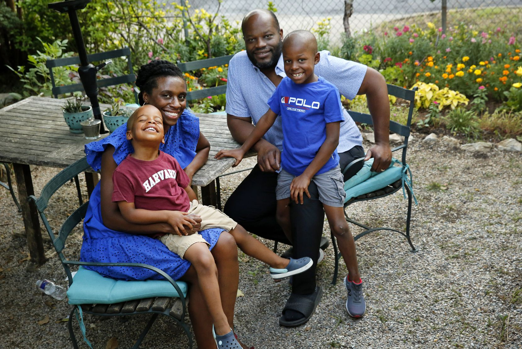 April Allen with her husband, Sean and their sons August (right) and Ellis at their Oak Cliff home last summer.