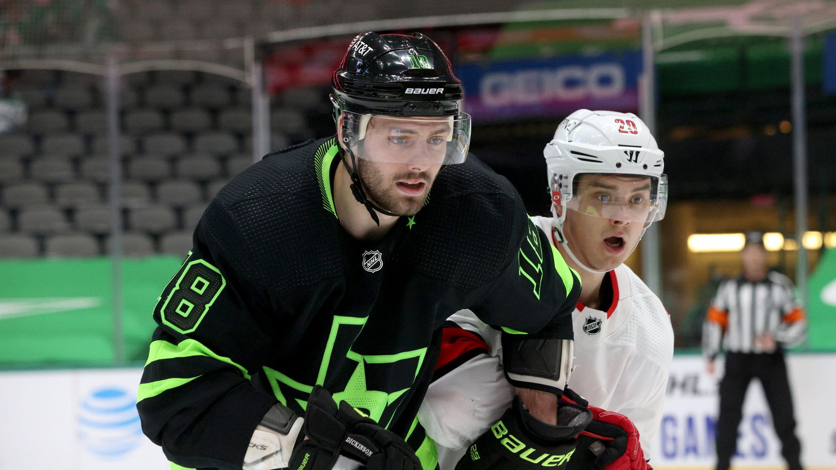 Dallas Stars center Jason Dickinson (18) defends against Carolina Hurricanes right wing Sebastian Aho (20) during the second period of play in a game at the American Airlines Center on Saturday, Feb. 13, 2021, in Dallas.