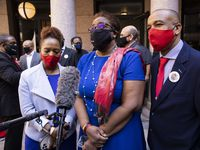 "Allison Jean (center) stands with daughter Alissa Findley (left) and husband Bertrum Jean while speaking to reporters following a press conference where Rep. Carl Sherman, D-DeSoto, introduced House Bill 929, also known as The Botham Jean Act ""Bo's Law"" Safe at Home, at the Texas Capitol in Austin on Monday, March 29, 2021. Botham Jean was murdered in his Cedars apartment by a Dallas police officer in September 2018. (Juan Figueroa/ The Dallas Morning News)"