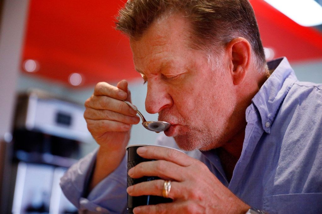 Founder Russell Hayward aspirates a spoonful of coffee during a cupping demonstration at Ascension Coffee's headquarters in Dallas, Thursday, July 26, 2018.  (Tom Fox/The Dallas Morning News)