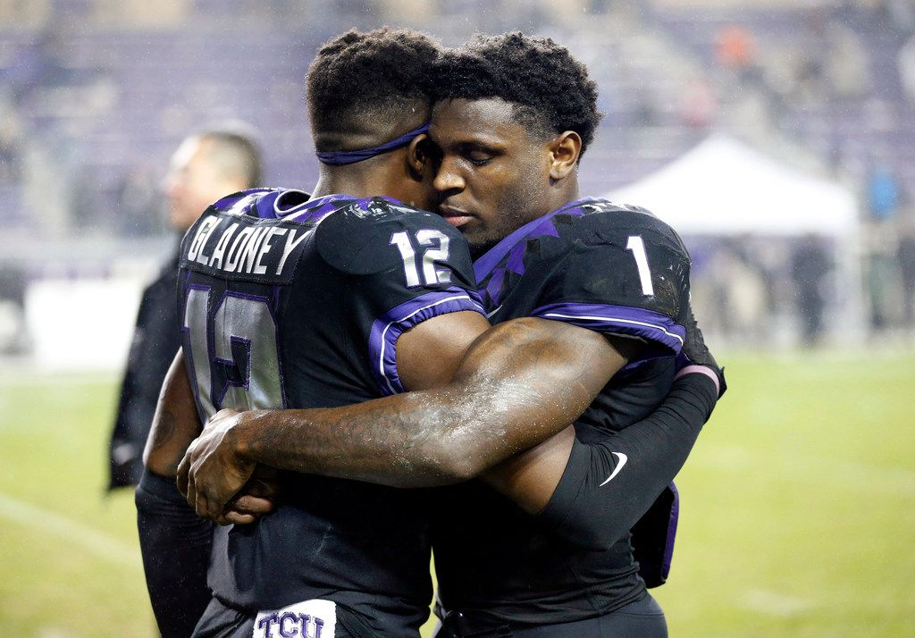 FILE - TCU wide receiver Jalen Reagor (1) hugs cornerback Jeff Gladney (12) after a loss to West Virginia at Amon G. Carter Stadium in Fort Worth on Friday, Nov. 29, 2019.