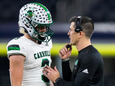 Southlake Carroll quarterback Quinn Ewers talks with head coach Riley Dodge during the fourth quarter of a Class 6A Division I area-round high school football playoff game between Southlake Carroll and DeSoto on Friday, November 22, 2019 at AT&T Stadium in Arlington.