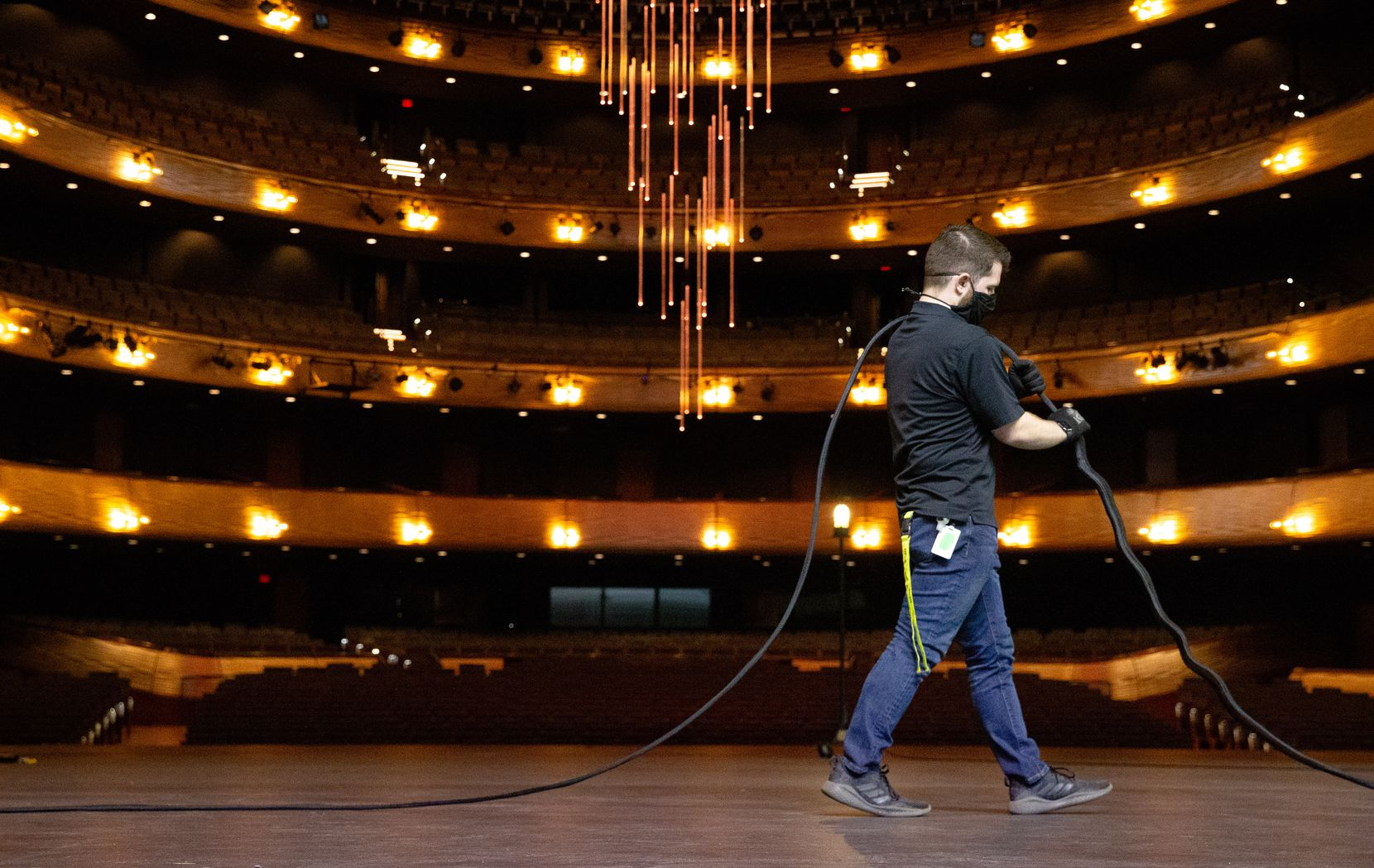 Jonathan White, head audio at the Winspear Opera House, does maintenance prep by making cable on stage in Dallas on Feb. 4, 2021.