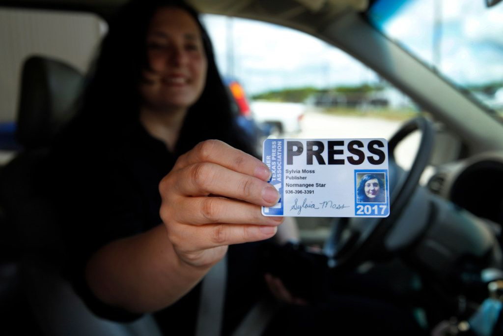 The Normangee Star newspaper owner and editor Sylvia Moss shows her press identification card, Tuesday, May 23, 2017, as she picks up her papers from the printer.