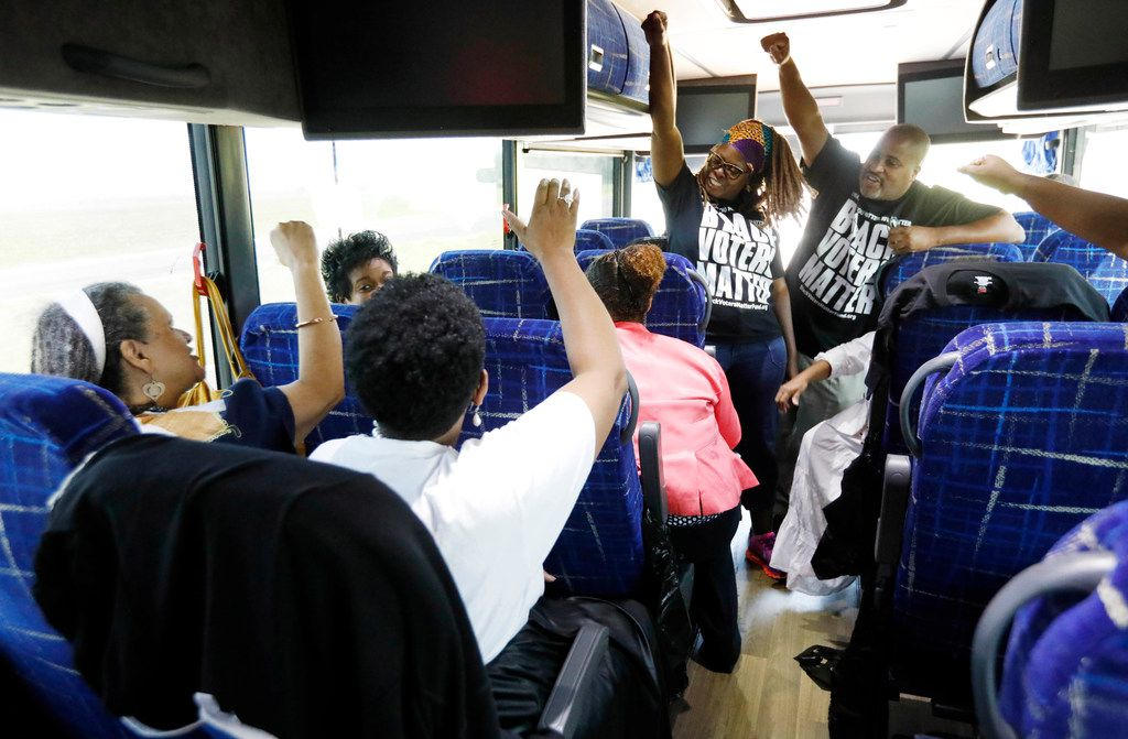 In this Aug. 24, 2018 photo, Black Voters Matter Fund co-founders, LaTosha Brown, left, and Cliff Albright, right, lead Mississippi grassroots partners in some empowerment cheers aboard a bus tour to Greenville, Miss. Brown said the time is now for black women to lead again. The Mississippi Delta was part of a three-state bus tour to build interest and excitement for the upcoming election with grassroots organizations, document the campaigning in locales with important upcoming races where black turnout will be key and expose traveling national media to the work led by mostly women leaders.