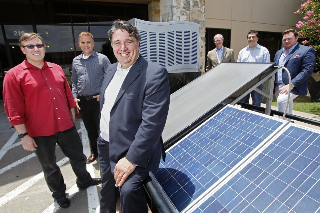 Benjamin Blumenthal, SunToWater Technologies co-founder and chief executive officer, and his team stand by one of the company's water generators. The units turn moisture in the air into drinkable water.