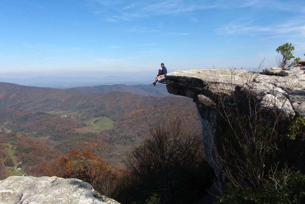 A hiker enjoys the view from atop McAfee Knob in the Blue Ridge Mountains of Virginia.