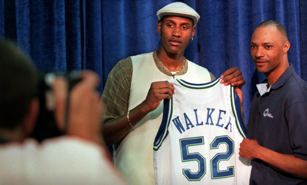 6/27/96--Dallas first-round draft pick  Samaki (cq) Walker poses for a photo with his new jersey and  coach Jim Cleamons (cq) for a team photographer Layne Murdoch (at  left) Thursday afternoon after a press conference at Reunion Arena. (Taken 6/27/96)