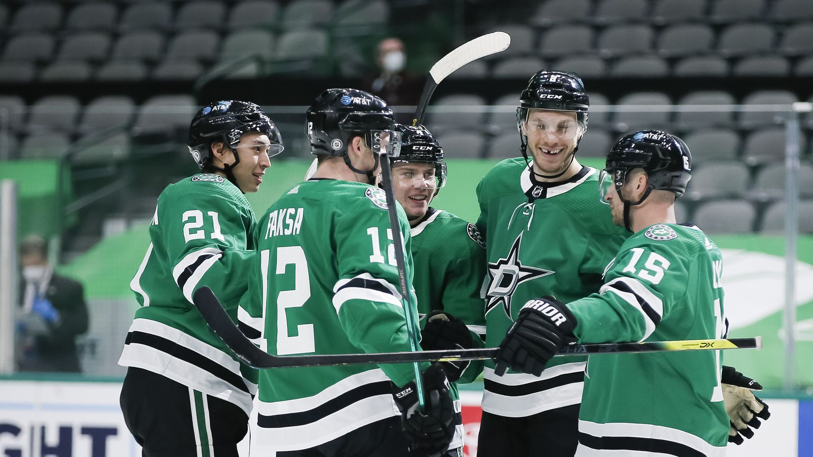 Dallas Stars forward Radek Faksa (12) is congratulated by teammates after scoring a goal during the first period of an NHL hockey game against the Nashville Predators in Dallas Sunday, March 21, 2021. (Brandon Wade/Special Contributor)