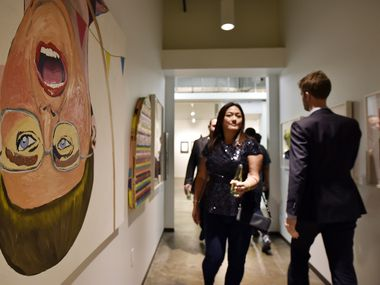 Mixed media on canvas, left, titled Sometimes a Woman isn't a Woman, 2013, by Alexander Paulus, during the Preview Gala of ninth annual Dallas Art Fair, Thursday evening, April 6, 2017 at the Fashion Industry Gallery in Downtown Dallas.