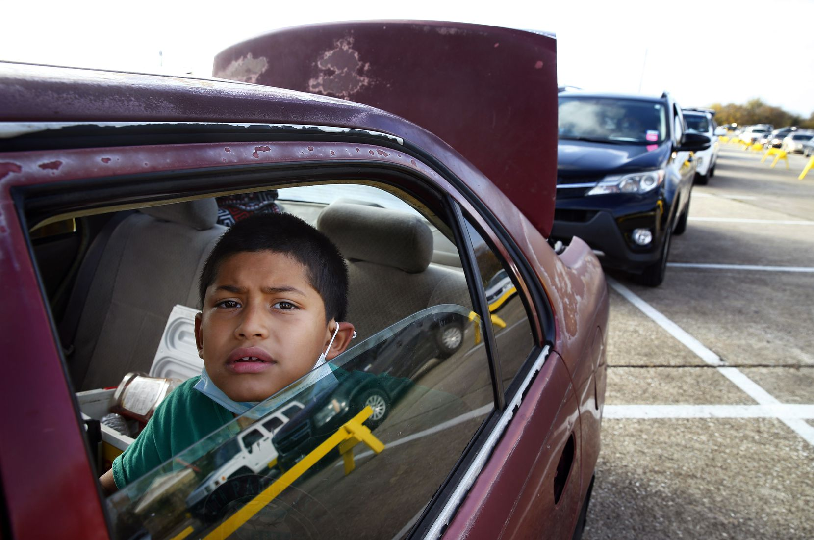 Ivan Gonzalez, 7, waited overnight with his stepfather in their car to get food.
