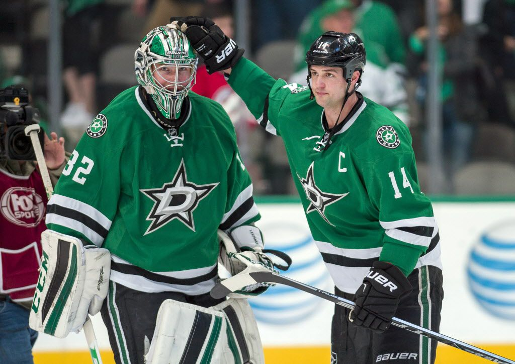 Mar 4, 2016; Dallas, TX, USA; Dallas Stars goalie Kari Lehtonen (32) and left wing Jamie Benn (14) celebrate the win over the New Jersey Devils at the American Airlines Center. The Stars defeat the Devils 3-2. Mandatory Credit: Jerome Miron-USA TODAY Sports