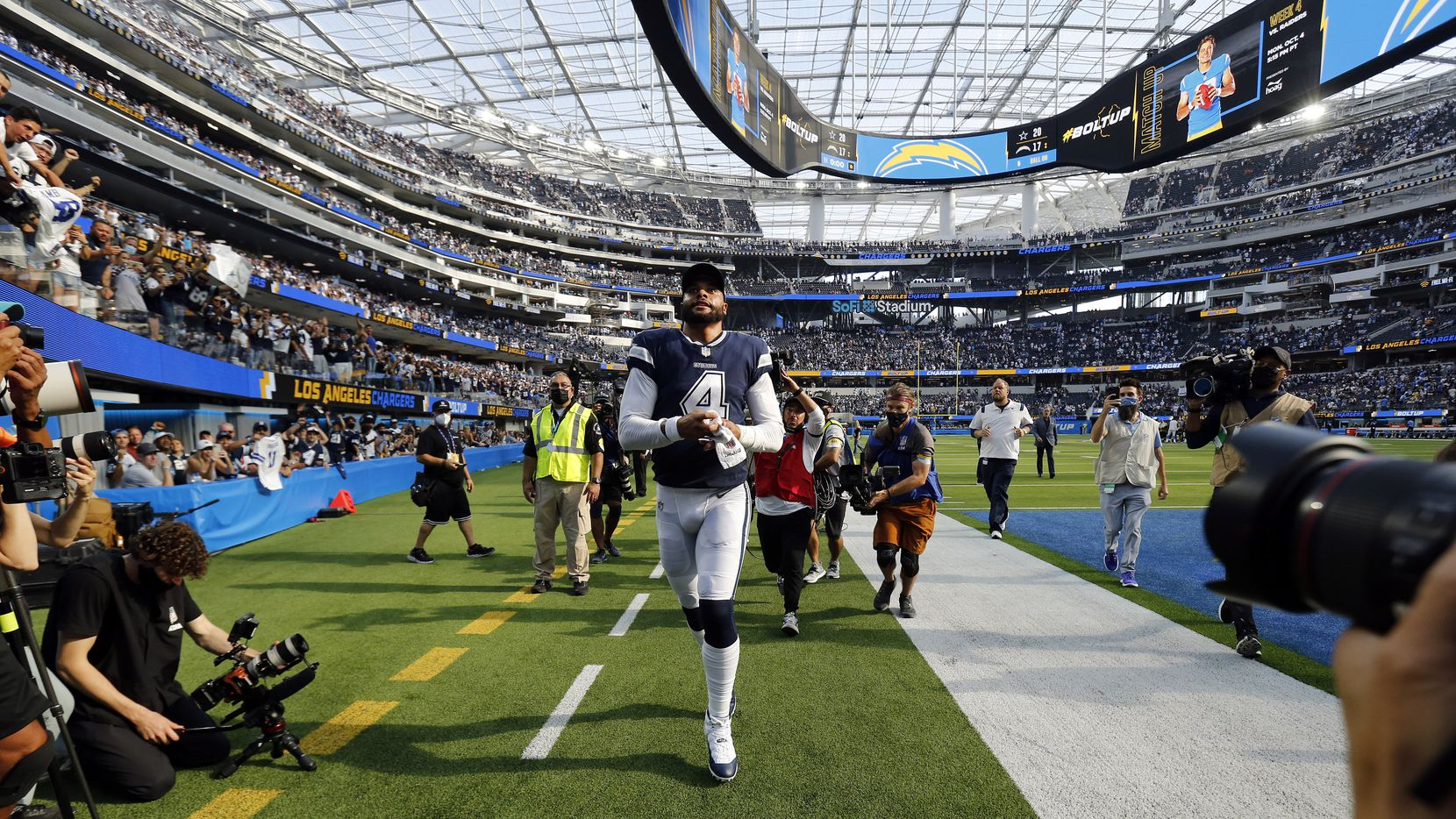Dallas Cowboys quarterback Dak Prescott (4) runs off the field after their win over the Los Angeles Chargers, 20-17, at SoFi Stadium in Inglewood, California, Sunday, September 19, 2021. The Cowboys won, 20-17.