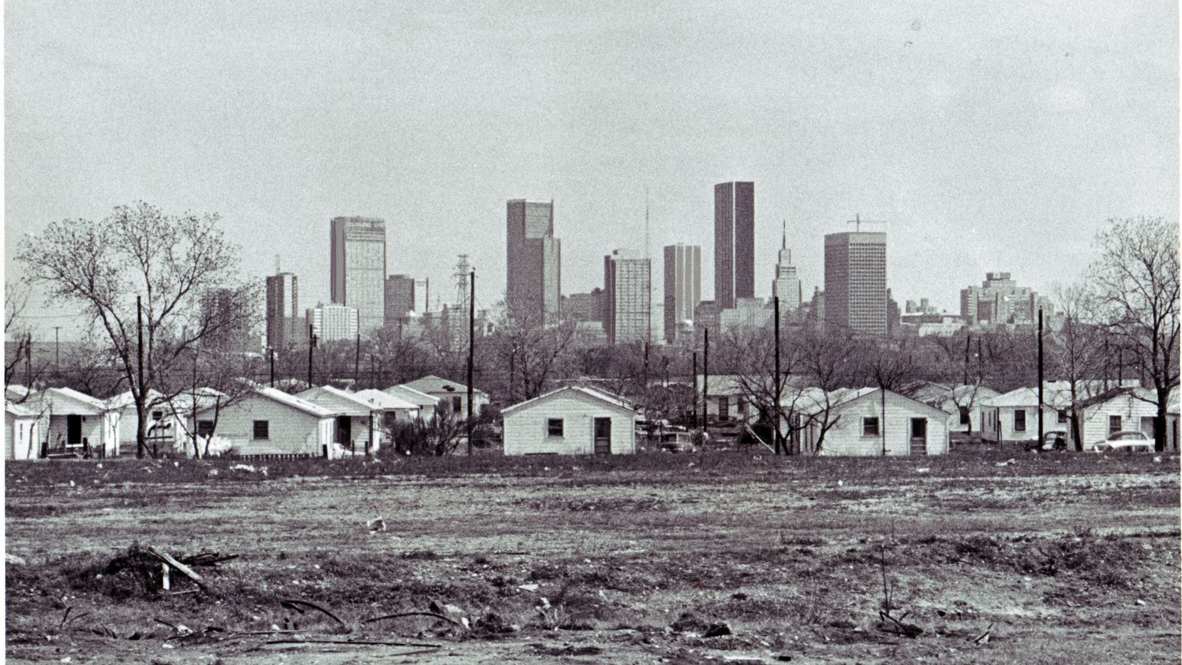 From The Dallas Morning News, Saturday, March 16, 1968 - Affluence and poverty of a growth city are reflected by Dallas' skyline looming beyond deteriorating homes. Dallas News staff photo by Bob W. Smith.  HARD COPY LOCATION: DALLAS - TEXAS - SKYLINE VIEWS 1968x1968
