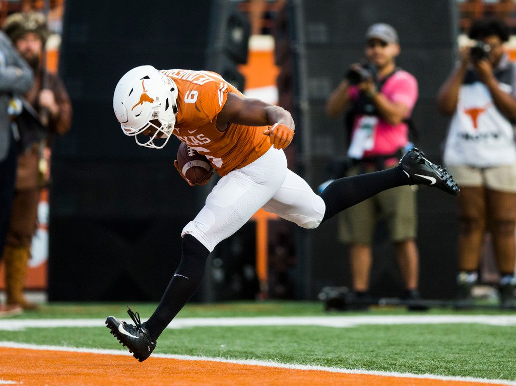 FILE - Texas wide receiver Devin Duvernay (6) scores a touchdown during the fourth quarter of a game against West Virginia on Saturday, Nov. 3, 2018, at Darrell K Royal-Memorial Stadium in Austin. (Ashley Landis/The Dallas Morning News)