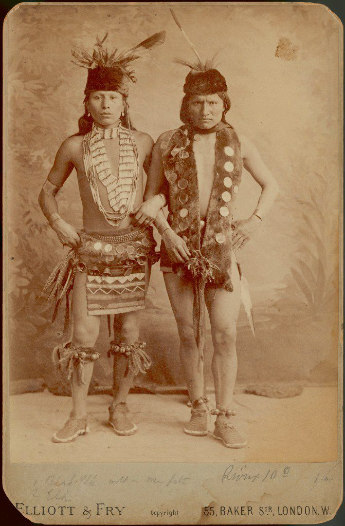 The young Black Elk, wearing his dance costume, as he appeared during the Wild West's 1887-88 tour of England. Black Elk's arm is linked through that of a scowling fellow performer identified as Elk. From Black Elk: The Life of an American Visionary,  by Joe Jackson.
