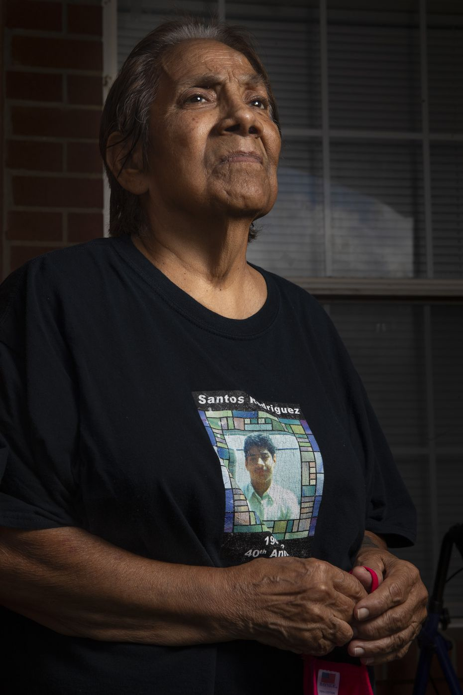"On the day before the 47th anniversary of her 12-year-old son's murder, Bessie Rodriguez posed for a portrait outside her home in Dallas on Thursday, July 23, 2020. She considers her son's death the ""coldest of all"" in the chain of carnage of Black and Latino victims. She also doesn't think change is coming soon in the justice system. (Lynda M. Gonzalez/The Dallas Morning News)"