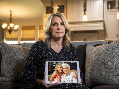Cheryl Pangburn holds a photo of her and her mother, Marilyn Bixler — taken at luxury senior living community Parkview in Frisco — at Pangburn's home in Frisco. Pangburn learned via social media that her mother may have been the victim of a serial killer.