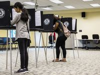 Zuleima Martinez (left) and Sananda McCall, vote in an election in Arlington. The primary for the November election is July 14.