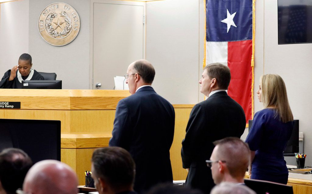 Fired Dallas police Officer Amber Guyger (right) listens as Assistant District Attorney Jason Hermus (not pictured) delivers the grand jury charge against her before his opening statement in the 204th District Court at the Frank Crowley Courts Building in Dallas, Monday, September 23, 2019.