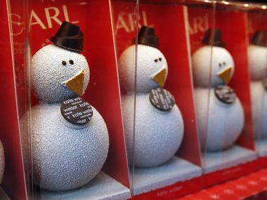 Carl the Drinking Chocolate Snowman for sale from Kate Weiser Chocolate at Stonebriar Centre in Frisco.