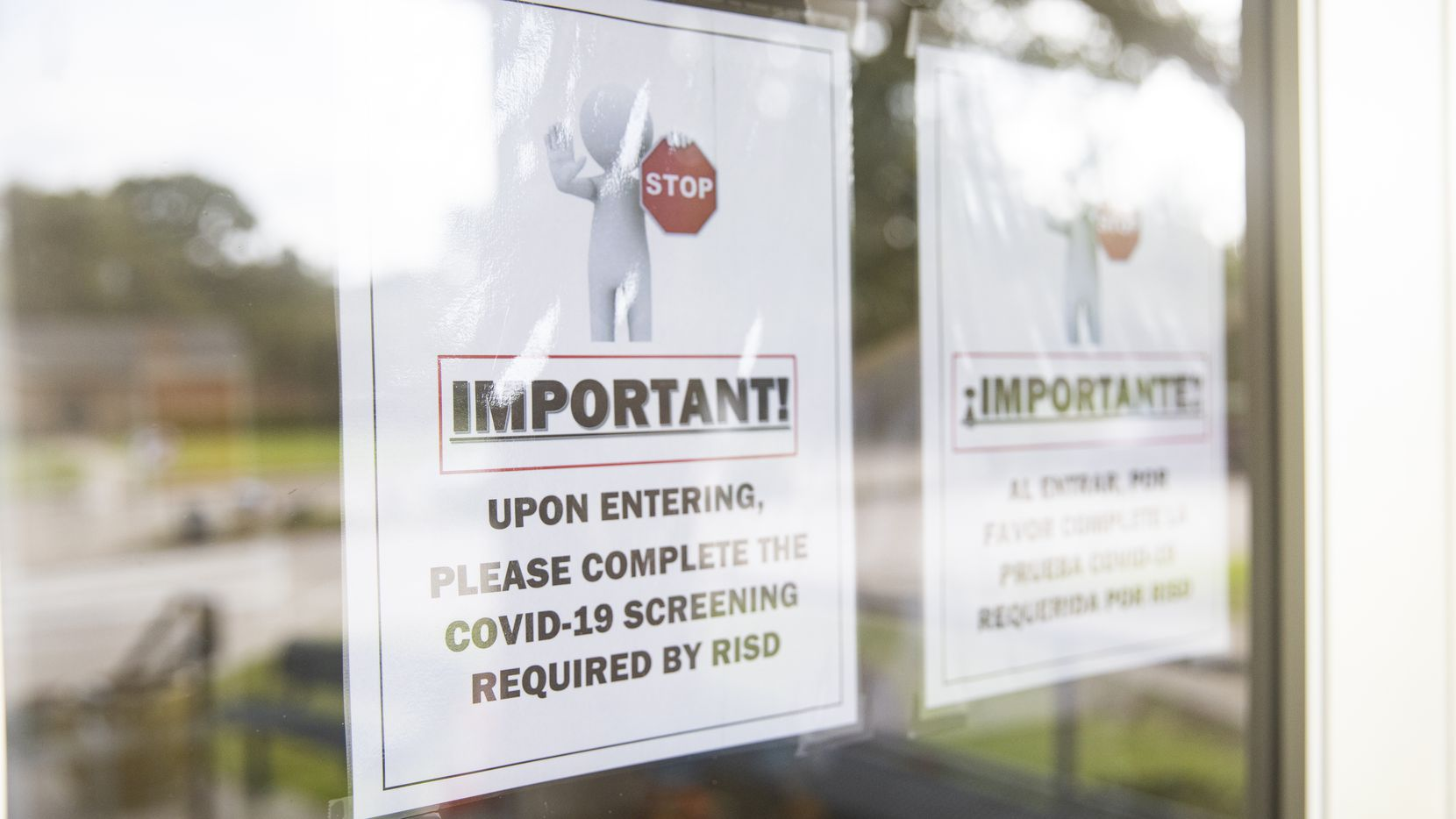 A sign about COVID-19 screening before entering Northwood Hills Elementary on Aug. 31, 2020 in Dallas.