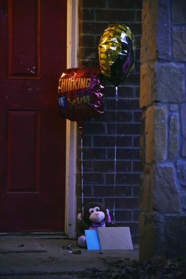 A small memorial with flowers, balloons and cards grew outside of the home the night after Rory and his uncle Jaylon were shot.
