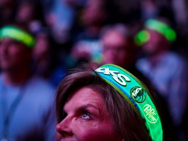 Dallas Mavericks fans wear lighted headbands before an NBA basketball game against the Philadelphia 76ers at American Airlines Center on Saturday, Jan. 11, 2020, in Dallas.