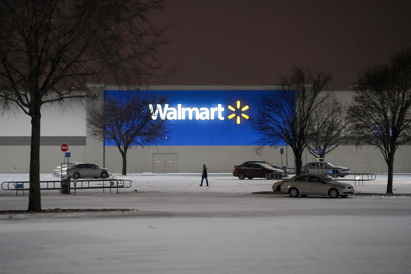 The parking lot of a Walmart Store on Coit Road empties as a second winter storm brought more snow and continued freezing temperatures to North Texas on Tuesday night, Feb. 16, 2021 in Plano. Walmart announced on Tuesday the chain would be closing 415 stores in Texas due to the weather.