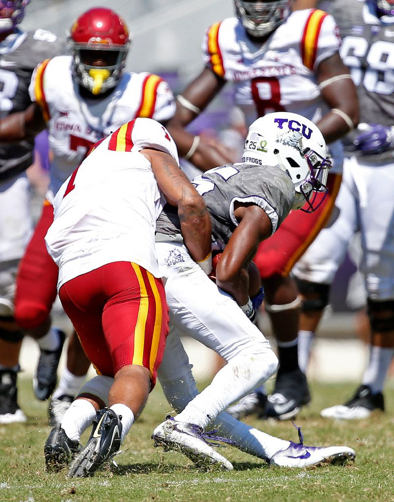 TCU wide receiver KaVontae Turpin (right) is tackled by Iowa State defensive back D'Andre Payne during the third quarter at Amon G. Carter Stadium in Fort Worth, Texas, Saturday, Sept. 17, 2016. Turpin injured his left knee on the play. (Jae S. Lee/The Dallas Morning News)