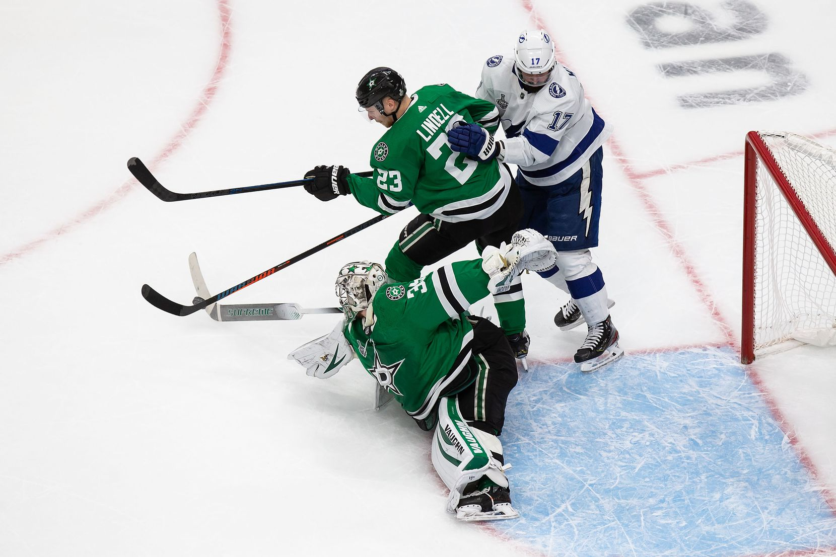 Goaltender Anton Khudobin (35) of the Dallas Stars loses his stick making a save against Alex Killorn (17) of the Tampa Bay Lightning during Game Three of the Stanley Cup Final at Rogers Place in Edmonton, Alberta, Canada on Wednesday, September 23, 2020. (Codie McLachlan/Special Contributor)