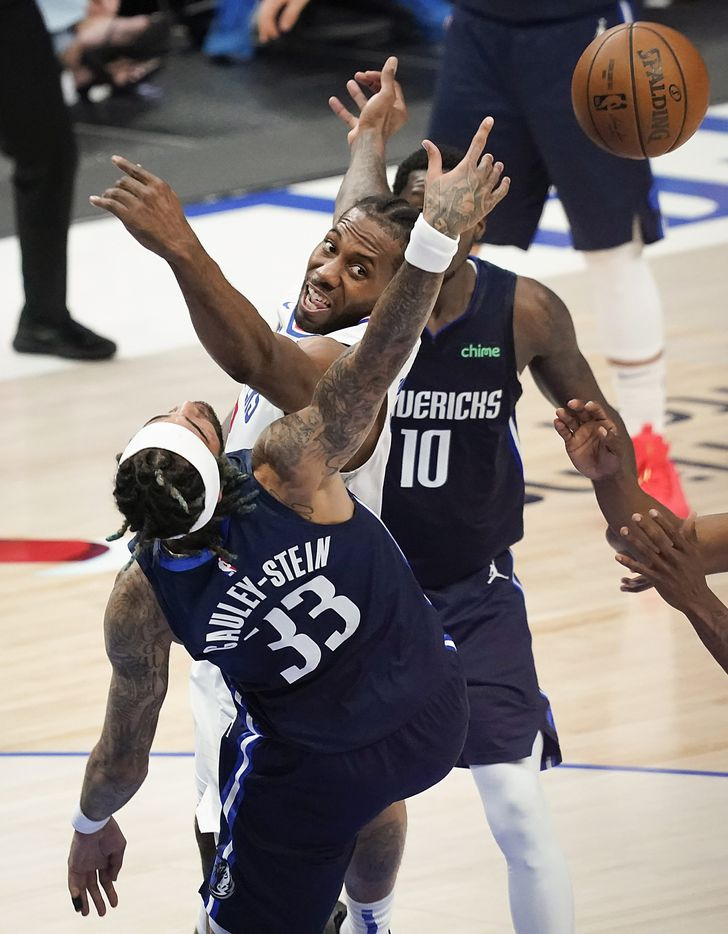LA Clippers guard Paul George (13) fights for a rebound against Dallas Mavericks center Willie Cauley-Stein (33) during the second quarter of an NBA playoff basketball game at American Airlines Center on Friday, May 28, 2021, in Dallas.