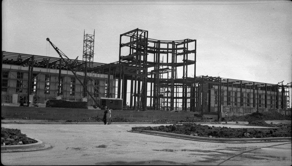 The State of Texas building, now known as the Hall of State building, under construction for the Texas Centennial Exposition at Fair Park. The photographer is J. Elmore Hudson, who was a draftsman for the U.S. Department of Agriculture and helped build/survey the Fair Park between 1935-1937 for the Centennial celebration.