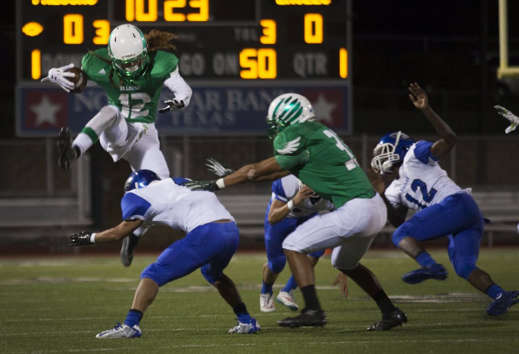 Lake Dallas senior wide receiver Keegan Brewer (12) jumps over Carter-Riverside senior defensive back Anson Truong (4) during their game on Friday, October 2, 2015. Photo by Kristen Watson/DRC