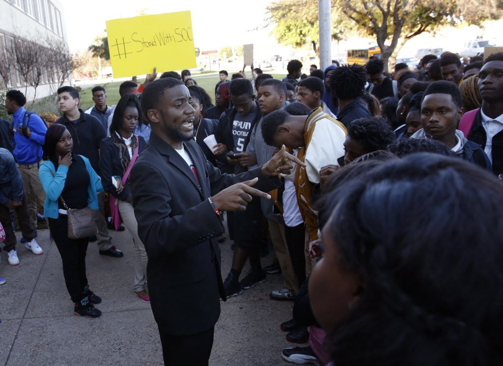 Dominque Alexander, president and founder of Next Generation Action Network, talks to student protestors and helps lead a walk-out protest against the building conditions at South Oak Cliff High School in Dallas on Dec. 7, 2015.