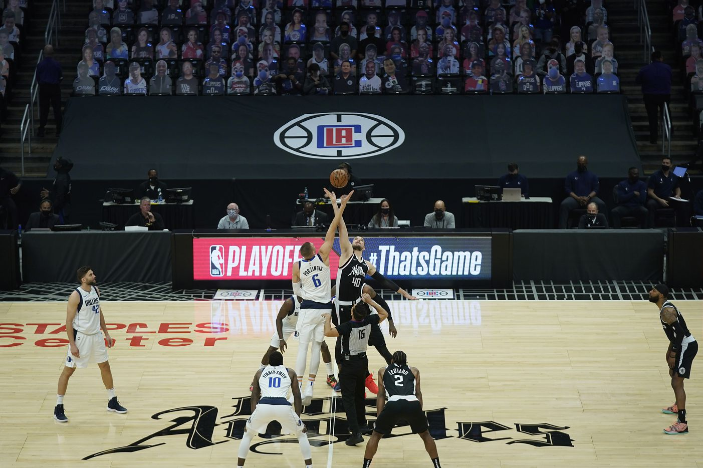Dallas Mavericks center Kristaps Porzingis (6) goes up for the opening tipoff against LA Clippers center Ivica Zubac (40) during the first half of an NBA playoff basketball game at Staples Center on Saturday, May 22, 2021, in Los Angeles.