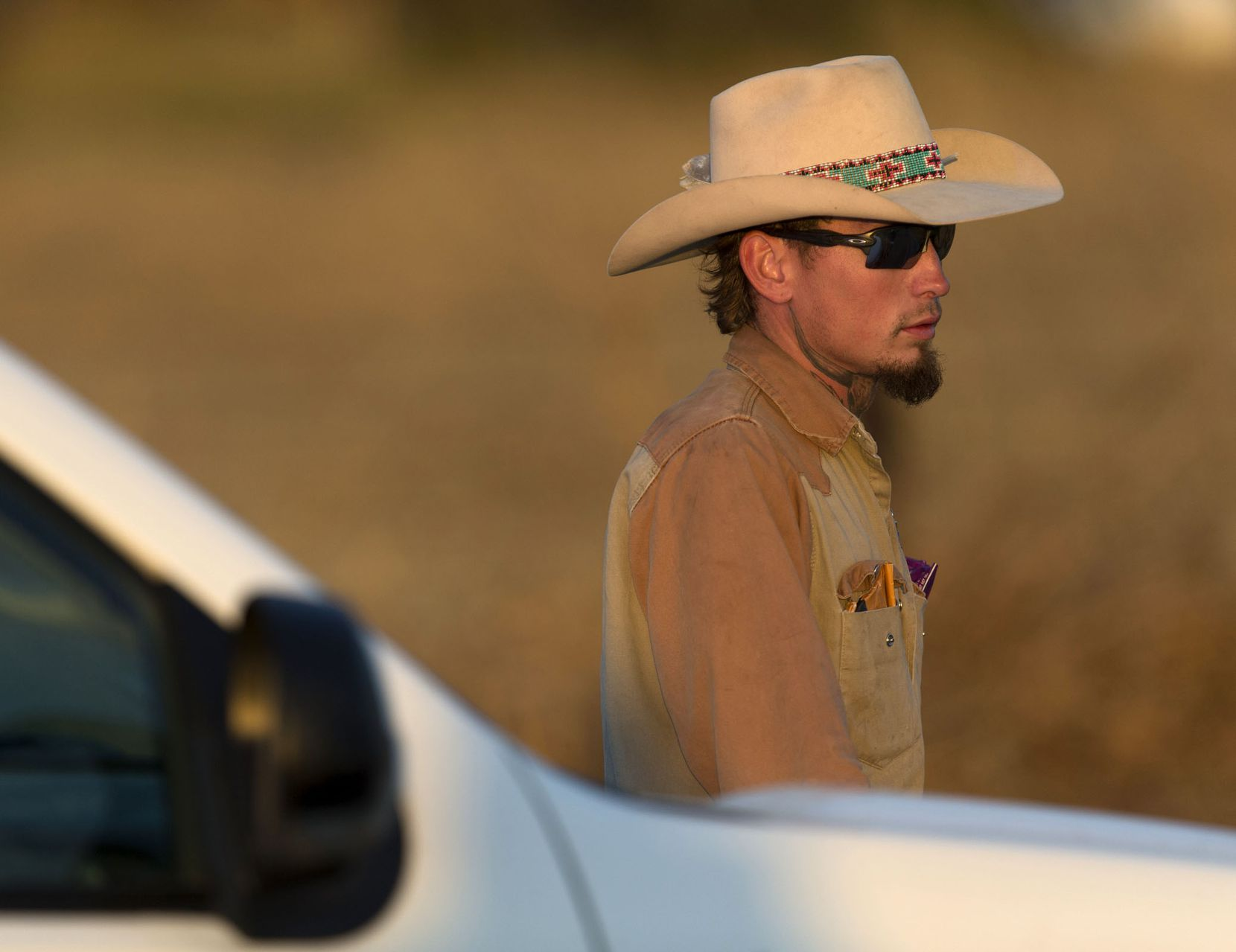 Johnny Langendorff, who was one of the men who said they pursued Devin Kelly after a deadly church shooting, waits to be picked up from the scene where Kelley was found dead near the intersection of FM539 and Sandy Elm Road in Guadalupe County.