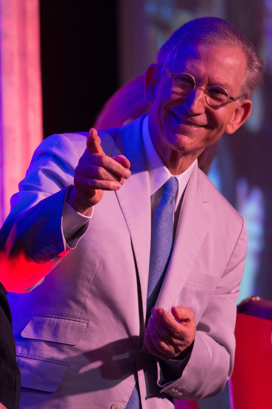 H-E-B chairman and CEO Charles Butt stands on stage during the 2015 H-E-B Excellence in Education Awards.
