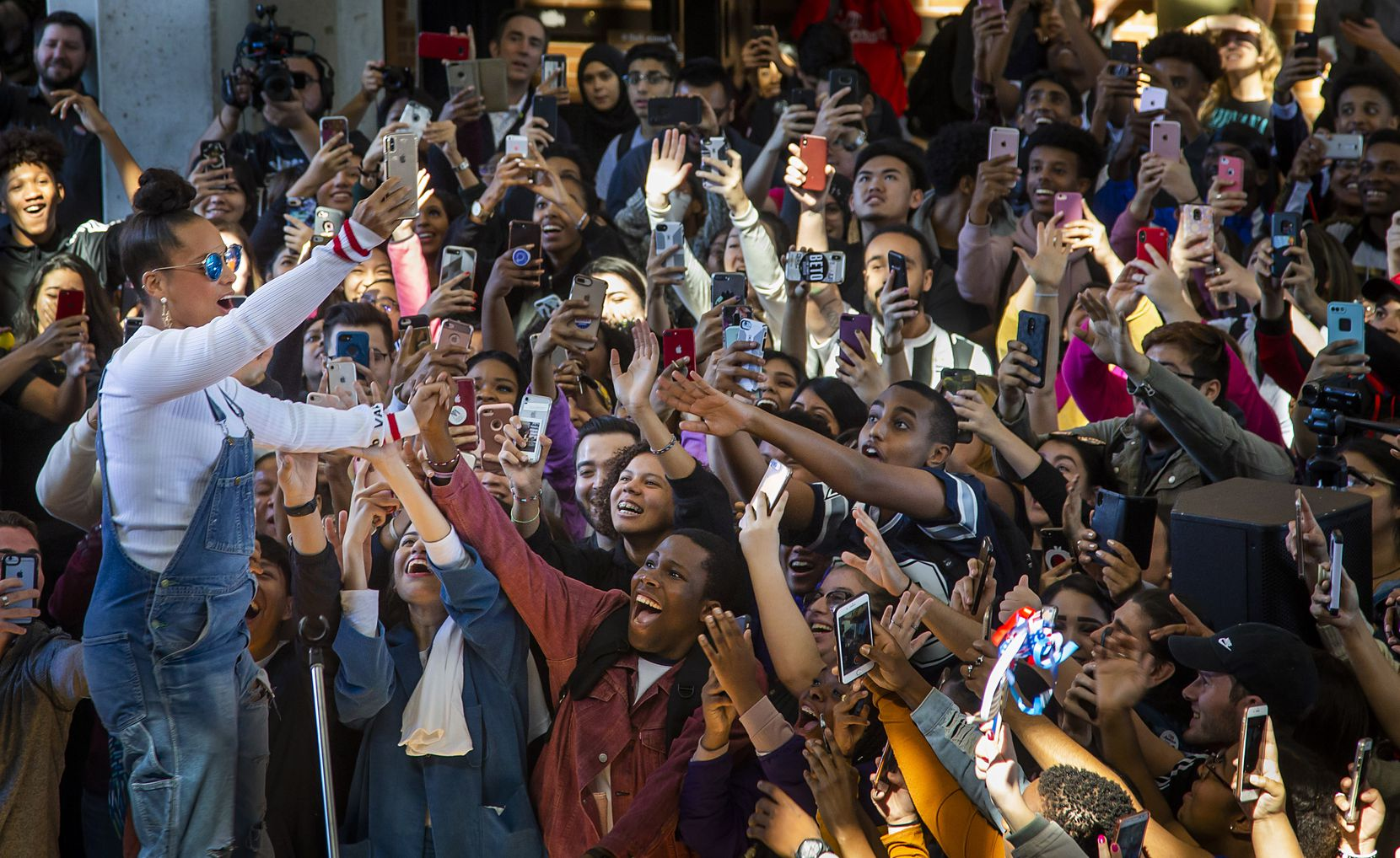 Singer Alicia Keys takes a selfie with the crowd during a youth voter rally at Richland College in Dallas on Oct. 23, 2018. Keys, joined ÒUgly BettyÓ star America Ferrera  and Liza Koshy for the event organized by Richland College Student Government Association, along with the Student Voter Initiative and Voto Latino. (Carly Geraci/The Dallas Morning News)