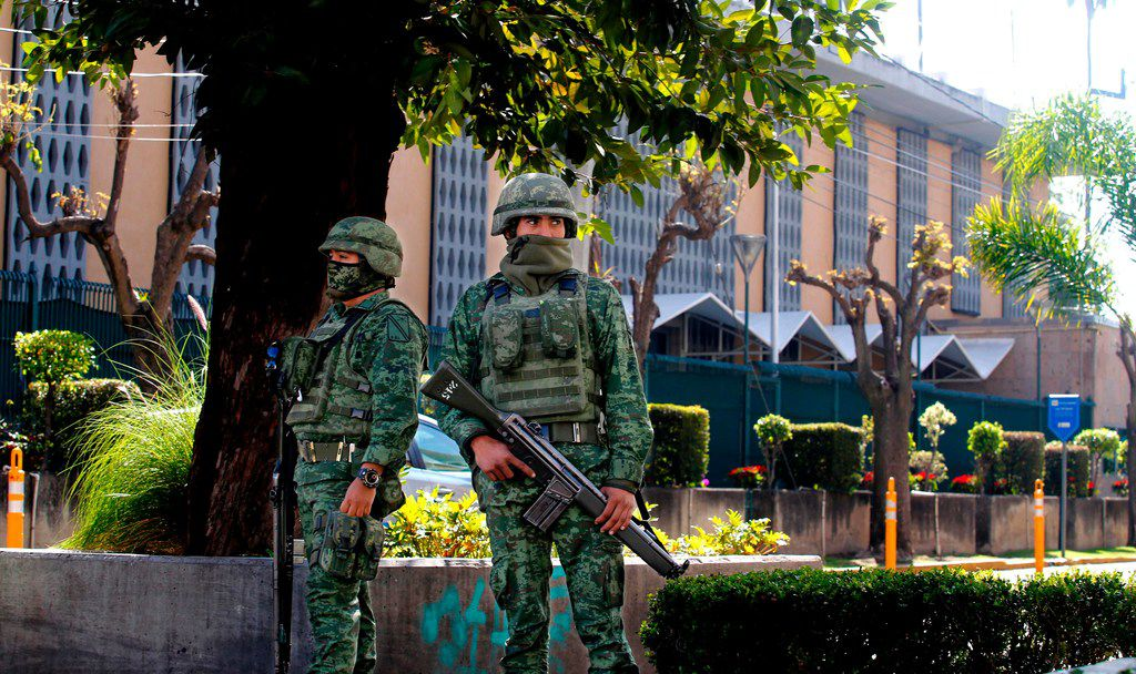 Members of the Mexican Army stand guard outside the U.S. Consulate in Guadalajara, Mexico on December 01, 2018, after an attack with an explosive device left a wall damaged but nobody injured.