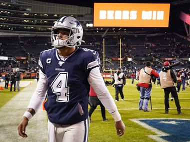 Dallas Cowboys quarterback Dak Prescott walks off the field after a loss to the Chicago Bears in an NFL football game at Soldier Field on Thursday, Dec. 5, 2019, in Chicago.
