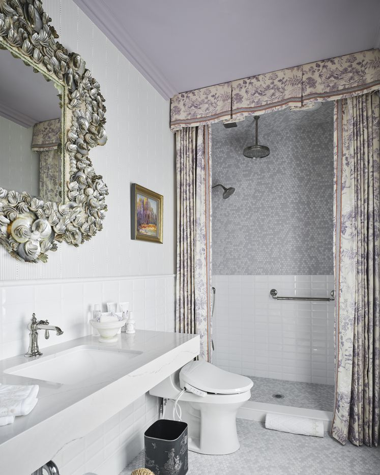 This space is the adjoining bathroom to the upstairs bedroom that Shelly Rosenberg of Acorn & Oak designed for the 2021 Kips Bay Decorator Show House Dallas. While she was not able to make the space ADA compliant due to a lack of space, Rosenberg created an adaptive design that can suit the needs of a person with disabilities including a ramp to get into the shower and smart home features that correspond to an adaptive device.